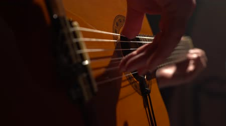 flamenco : Guitar mens fingers touch the strings. Close up