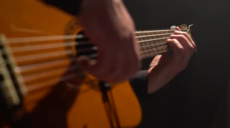гитара : Guitar mens fingers touch the strings. Close up