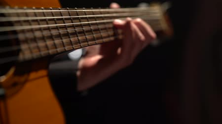 flamenco : Guitar the male fingers fingering . Close up