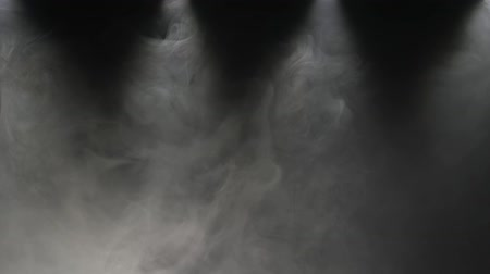 creeping : Background slow motions smoke on a black. Professional film studio light and smoke
