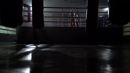 searchlight : Two girl in the ring fight in the dark