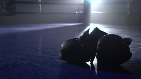 ring : Boxing gloves lie on the floor of the ring. Close up