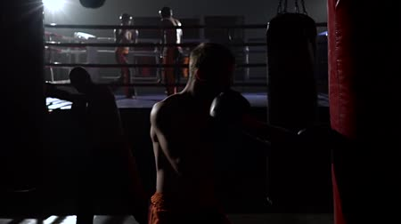 wrestler : Kickboxers preparing for competitions . Slow motion