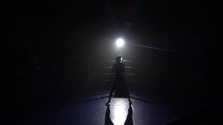 postura : Girl kickboxer preparing for the competition . Silhouette. Slow motion Stock Footage