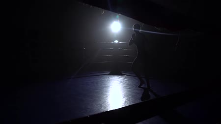 direto : Girl kickboxer preparing for the competition . Silhouette. Slow motion Stock Footage