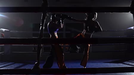 tekmeleme : Sparring in the ring between two girls . Slow motion