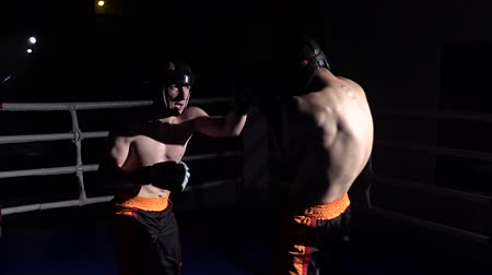 wrestler : Two guys in the ring fight in the dark . Slow motion Stock Footage