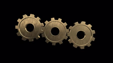 continuity : Gears spinning flies alone and become one gear. Black background. Alpha channel Stock Footage