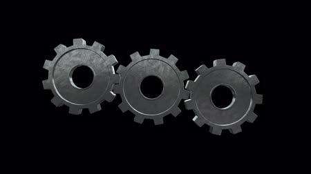 mekanizma : Gears spinning flies alone and become one silver gear. Black background. Alpha channel