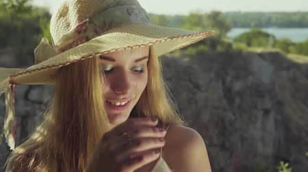 taş ocağı : Girl on a background of a beautiful landscape smiling. Slow motion. Close up Stok Video