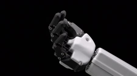 convenção : Robots hand moves his fingers . Black background . Close up. Slow motion