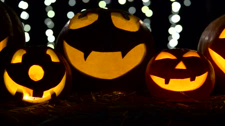 fete : Halloween and holidays concept - spooky jack-o-lantern or carved pumpkin. Close up. Black bokhe background