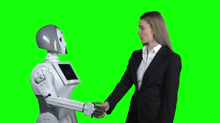 takes : Girl welcomes the robot takes his hand and says hello. Green screen