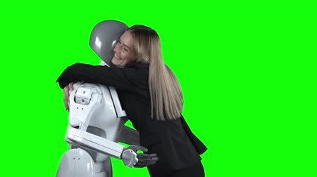 podání ruky : Girl hugs the robot. Green screen
