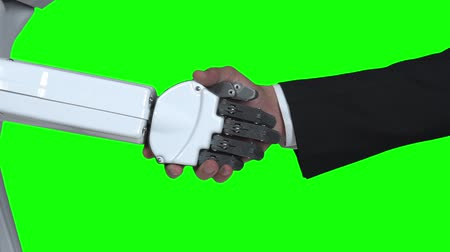 hallo : Robot shakes hands with a guy greets him. Green screen. Close up. Slow motion Stockvideo