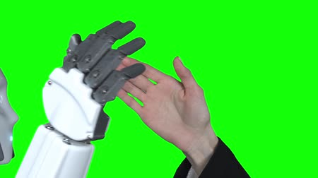 застежка : Hand of a woman and a robot hand give five . Green screen. Close up. Slow motion