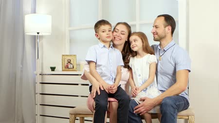 devanear : Family sitting on the couch and talking Stock Footage