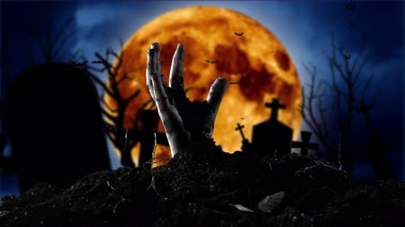 defin : Zombie hand coming out of the grave. Graveyard background