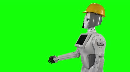 steward : Robot in a builders helmet waves hi and talks. Green screen. Side view