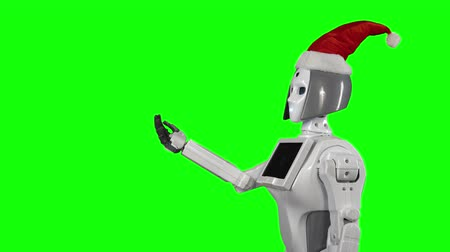 itself : Robot wearing a Santa Claus hat is calling for a hand gesture. Green screen. Side view