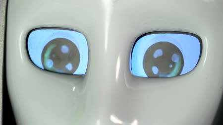 directional : Eyes of the robot are on and off. Close up