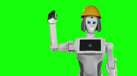 do widzenia : Robot in an orange builders helmet waves bye. Green screen. Slow motion