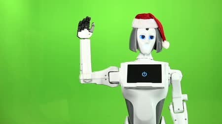itself : Robot in a hat Santa waving hi. Green screen. Slow motion