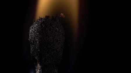 明るく照らされた : Match instantly lights up and goes out. Slow motion. Black background. Close up
