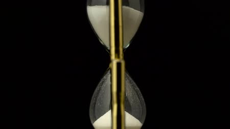 навсегда : Hourglass is made of glass wooden and sand. Black background
