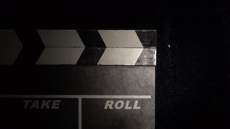 мел : Clapper board close up. Black background