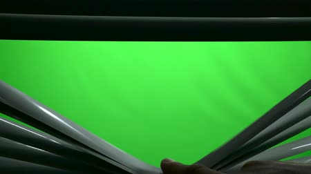 redőnyök : Human finger in the dark opens the jalousie. Green screen Stock mozgókép