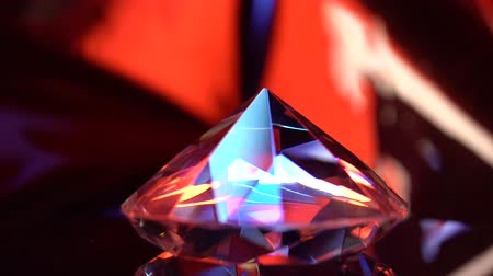 facets : Diamond is spinning and shimmering with red and blue color