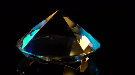 fiancee : Diamond slowly rotates with a sharp end up. Black background Stock Footage