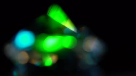 facets : Abstract lights bokeh in blue green and white. Black background Stock Footage