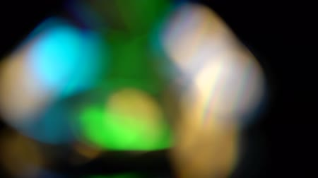 facets : Abstract lights bokeh in blue green and orange. Black background Stock Footage