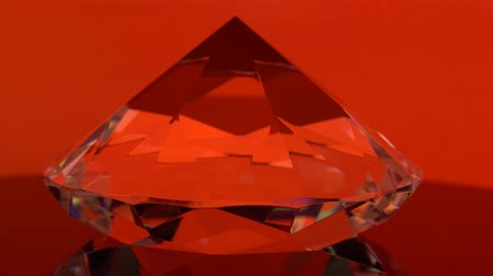 faceta : Diamond is spinning and shimmering with red color. Red background