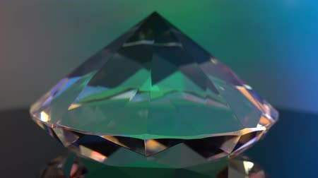facets : One diamond turns and shimmers in gentle tones Stock Footage