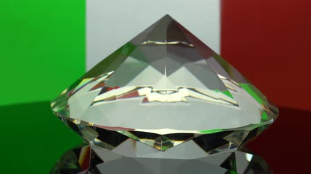 faceta : Transparent diamond rotates at one point. Italy flag background