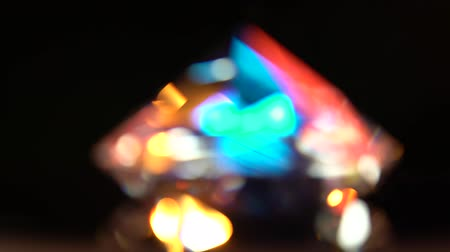 facets : Abstract lights bokeh in red blue yellow and white. Black background