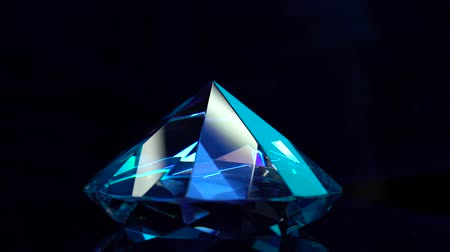 věčnost : Dear diamond is spinning and shimmering blue highlights. Black background