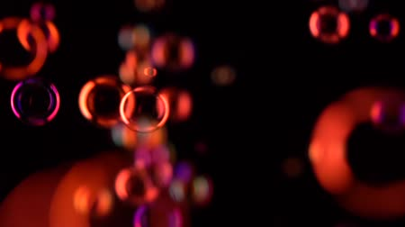 disk : Red soap bubbles fly in the air. Slow motion. Black background