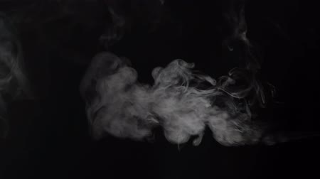 vertically : Vertically positioned white smoke over black background
