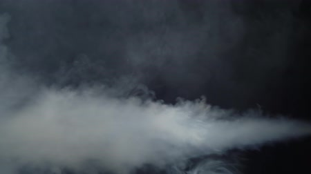 witchcraft : White smoke moving to the left side black background Stock Footage