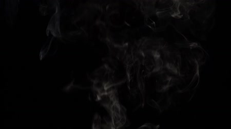 black and white : Smoke billowing on black background. Slow motion Stock Footage
