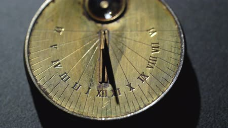 pocket watch : Solar vintage clock. Black background. Close up