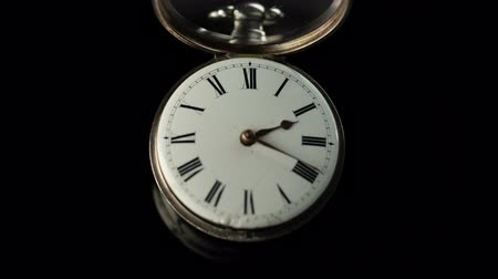 going round : Old vintage clock mechanism watch time going fast . Black background. Time lapse Stock Footage