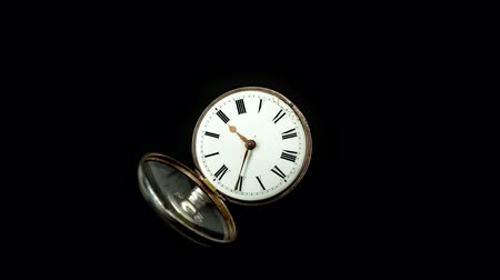 pocket watch : Vintage pocket watch rotate arrows go. Black background. Time lapse Stock Footage