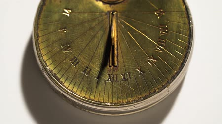 antique grunge : Solar pocket watch running from the rays of the sun . White background. Close up