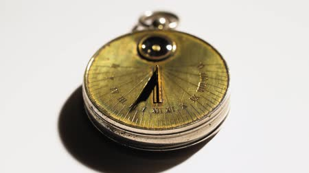 pocket watch : Sundial from the rays of the sun show time. White background. Close up