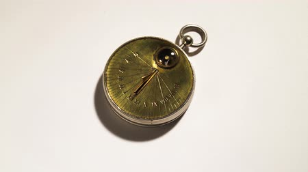 pocket watch : Solar watch is a mechanism rotate . White background. Close up